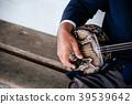 hand playing Sanshin Okinawa music instrument 39539642