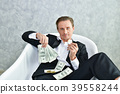 Concept Very wealthy businessman. Businessman is happy with his 39558244