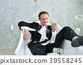 Concept Very wealthy businessman. Businessman is happy with his 39558245