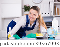 Smiling woman cleaning room 39567993