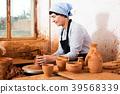 Female elderly master among the pottery 39568339