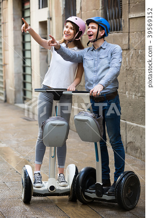 Young couple going sightseeing by segways 39569152