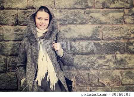 teenager girl in hood near wall 39569293