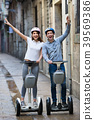 Positive boy and girl posing on segways in vacation 39569386