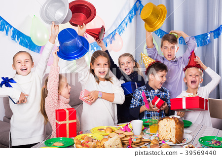 Children exchanging presents at party 39569440