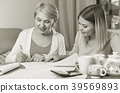 Daughter helps mother to lead home accounting 39569893