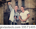 Guys photographed on the phone 39571405