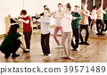 Young ballet dancers exercising in ballroom 39571489