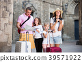 Family with kids making photo and holding map on vacation 39571922