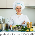Professional chef cooking fresh trout at kitchen 39572587