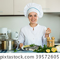 Professional chef cooking fresh trout at kitchen 39572605