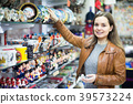 Woman shopping in souvenir store 39573224