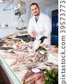 man, fish, cockerels 39573773