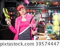 female is standing with new rockets for tennis and padel 39574447