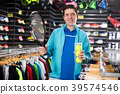 male holding new rocket and balls for tennis 39574546