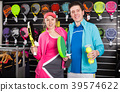 female and male with racket and ball 39574622