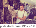 Male customer choise camouflage bag 39575231