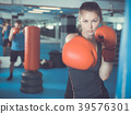 Woman boxing in gym 39576301