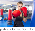 Portrait of woman who is training in box gym. 39576353
