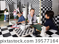 children play in escape room in chess style 39577164