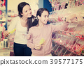 female, buying, candies 39577175