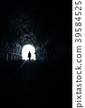 The man walked toward the light of the hole 39584525