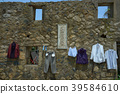 Clothes and pants hanging on an outdoor ancient wall 39584610