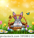 Cute Easter bunny in a basket with colorful eggs o 39586119
