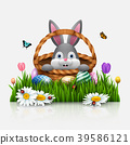 Cute Easter bunny in a basket with colorful eggs o 39586121