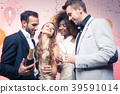 Couples in a club celebrating new years eve 39591014