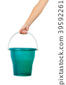 hand holding a bucket on an isolated white backgro 39592261