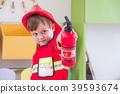 Caucasian boy kid dress up to fireman 39593674