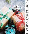 Christmas gifts with ribbons and snow. Clock 39598025