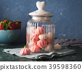 Pink and white meringues in glass jar with heart 39598360