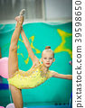 Little active beautiful gymnast in competitions of 39598650