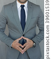 Torso of anonymous businessman standing with hands 39601539