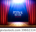 A theater stage with a red curtain and spotlight.  39602334