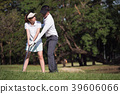 Asian young couple playing golf on golf course 39606066