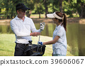 Asian young couple playing golf on golf course 39606067