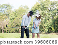 Asian young couple playing golf on golf course 39606069