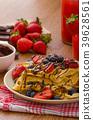 Belgian waffles with blueberries, strawberries 39628561