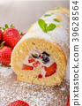 Sponge roll with strawberries and blueberries 39628564