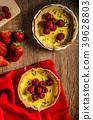 Lemon tart with rosemary and berries 39628803