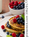 Pancakes with forest fruit and mint 39629177