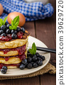 Glutten-free pancakes with jam and blueberries 39629720