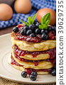 Glutten-free pancakes with jam and blueberries 39629735