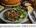 Grilled pork chops with lettuce salad 39631443