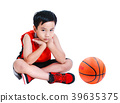 Unhappy asian child sit near basketball. Isolated 39635375