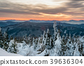 sunrise in snowy mountains 39636304