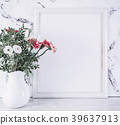 Blank frame and pink flowers over marble table 39637913